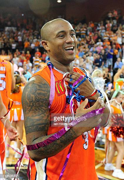 Ayinde Ubaka of the the Taipans celebrates after winning game two of the NBL Grand Final series between the Cairns Taipans and the New Zealand...