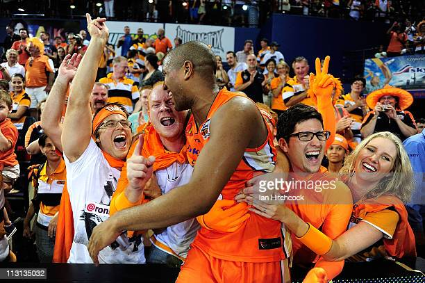 Ayinde Ubaka of the the Taipans celebrates with fans after winning game two of the NBL Grand Final series between the Cairns Taipans and the New...