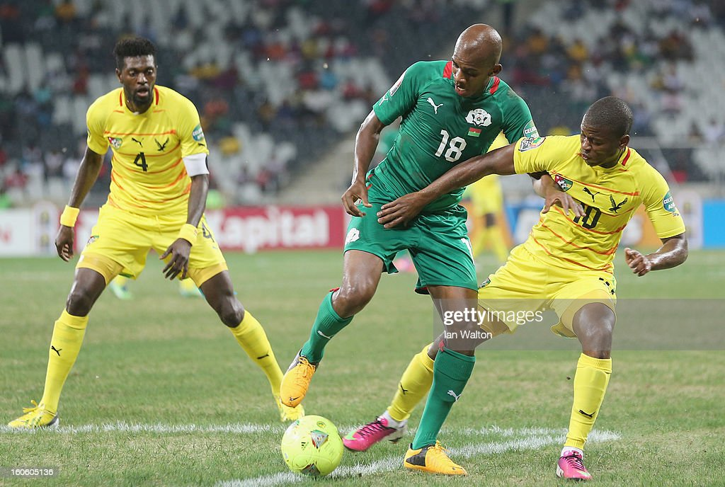 Ayite Floyd Ama of Togo is tackled by Kabore Charles of Burkina Faso during the 2013 Africa Cup of Nations Quarter-Final match between Burkina Faso and Togo at the Mbombela Stadium on February 3, 2013 in Nelspruit, South Africa.