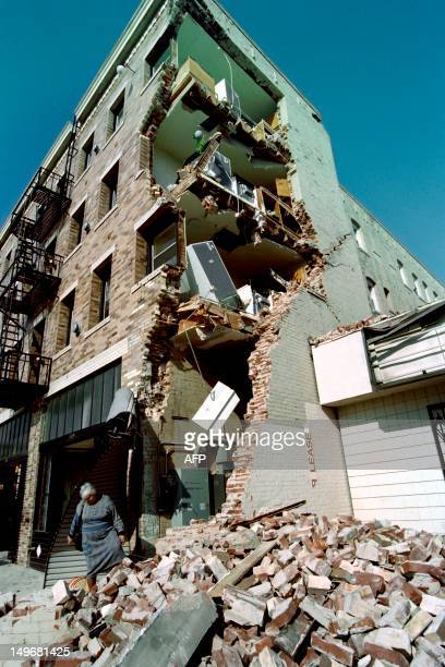 Aykui Alaverdyan walks over rubble after taking some of her belongings from her Hollywood Boulevard apartment building on January 20 1994 that was...