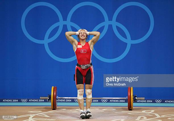 Aylin Dasdelen of Turkey shows her disappointment after a failed lift in the women's 58 kg category weightlifting competition on August 16 2004...