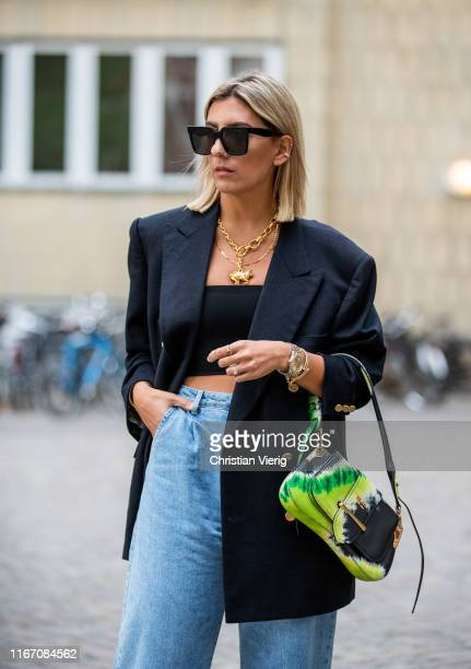 Aylin König is seen wearing denim jeans cropped top blazer Prada bag outside Saks Potts during Copenhagen Fashion Week Spring/Summer 2020 on August...