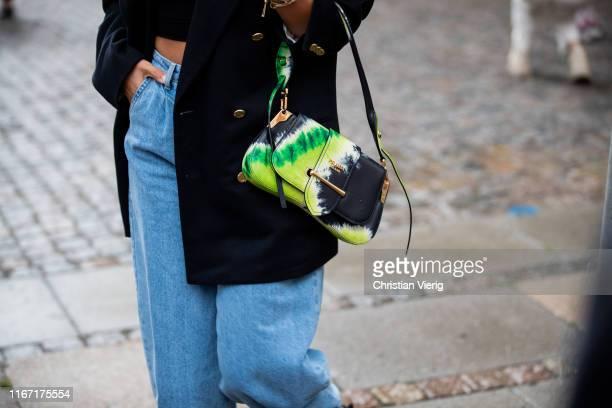 Aylin König is seen wearing denim jeans Prada bag outside Saks Potts during Copenhagen Fashion Week Spring/Summer 2020 on August 08 2019 in...