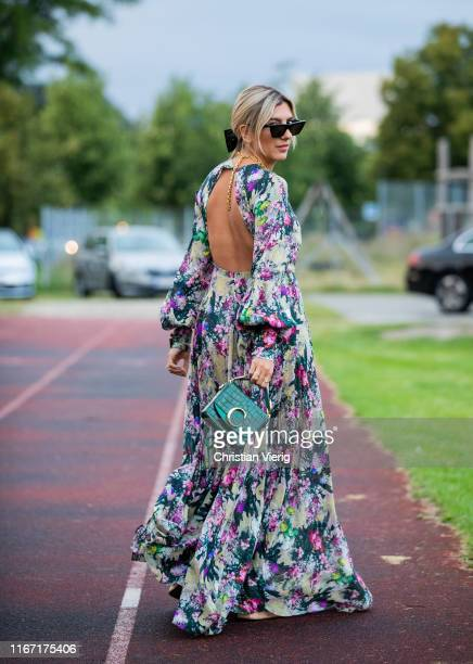 Aylin König wearing dress with floral print is seen outside Rotate during Copenhagen Fashion Week Spring/Summer 2020 on August 08, 2019 in...
