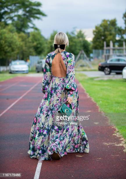 Aylin König wearing dress with floral print is seen outside Rotate during Copenhagen Fashion Week Spring/Summer 2020 on August 08 2019 in Copenhagen...