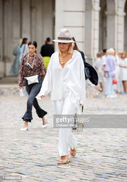 Aylin König wearing hat white button shirt Dior bag is seen outside Lala Berlin during Copenhagen Fashion Week Spring/Summer 2020 on August 08 2019...