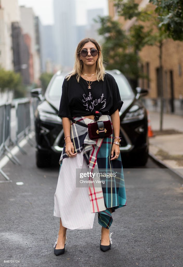Aylin Koenig in front of a Lexus seen in the streets of Manhattan outside Marchesa during New York Fashion Week on September 13, 2017 in New York City.