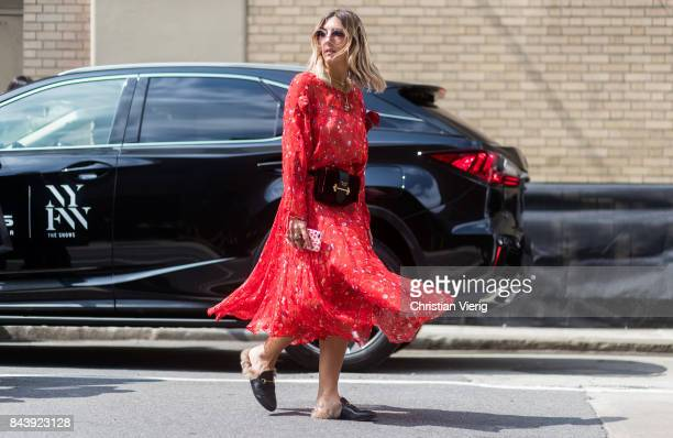 Aylin Koenig in front of a Lexus seen wearing a red Preen dress Prada belt bag in the streets of Manhattan outside Desigual during New York Fashion...