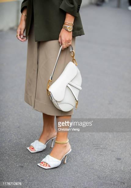 Aylin Koenig is seen weairng white Bottega Veneta heels Dior bag midi skirt olive blazer outside Boss during Milan Fashion Week Spring/Summer 2020 on...
