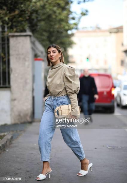 Aylin Koenig is seen wearing a Bottega Veneta bag, beige blouse and jeans before Sportmax during Milan Fashion Week Fall/Winter 2020-2021 on February...