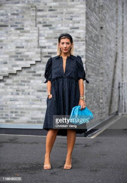 Aylin Koenig is seen wearing blue clutch navy dress outside Brøgger during Copenhagen Fashion Week Spring/Summer 2020 on August 06 2019 in Copenhagen...