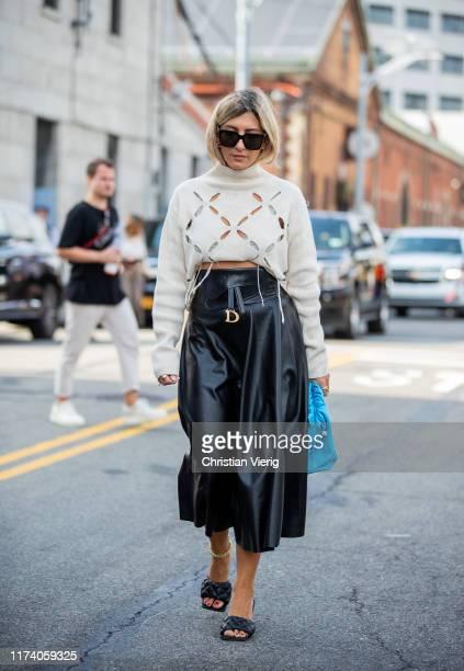 Aylin Koenig is seen wearing cropped top black skirt Dior blue clutch outside Michael Kors during New York Fashion Week September 2019 on September...