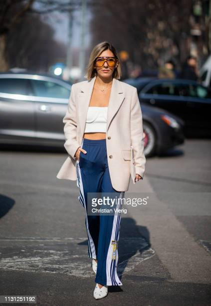 Aylin Koenig is seen wearing jogger pants cropped top blazer outside Armani on Day 2 Milan Fashion Week Autumn/Winter 2019/20 on February 21 2019 in...