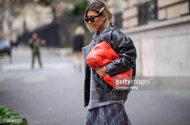 Aylin Koenig is seen wearing Margiela bag,, leather jacket, asymmetric skirt during Paris Fashion Week Womenswear Fall/Winter 2019/2020 on March 01,...