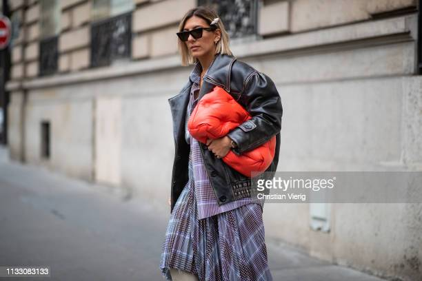 Aylin Koenig is seen wearing Margiela bag leather jacket asymmetric skirt during Paris Fashion Week Womenswear Fall/Winter 2019/2020 on March 01 2019...