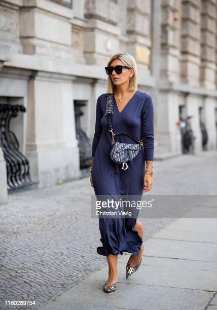 Aylin Koenig is seen wearing navy dress, Dior bag, Balenciaga heels during Berlin Fashion Week on July 04, 2019 in Berlin, Germany.