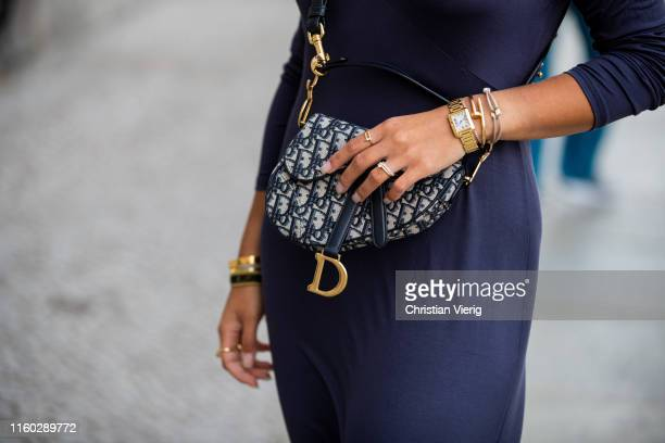 Aylin Koenig is seen wearing navy dress, Dior bag during Berlin Fashion Week on July 04, 2019 in Berlin, Germany.