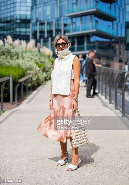 Aylin Koenig is seen wearing silk skirt sleeveless zipped knit outside the Sportmax show during Milan Fashion Week Spring/Summer 2020 on September 20...