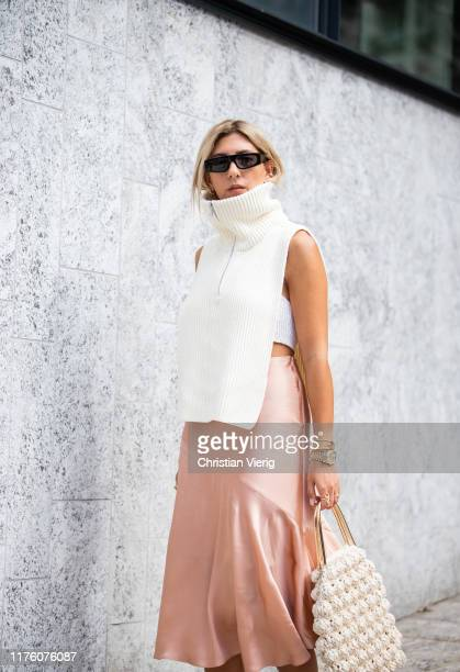 Aylin Koenig is seen wearing silk skirt sleeveless zipped knit outside the Sportmax show during Milan Fashion Week Spring/Summer 2020 on September 20...
