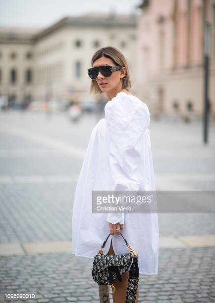 ce8f84ab3be Aylin Koenig is seen wearing white dress Calvin Klein 205W39NYC Dior saddle  bag Dior sunglasses during