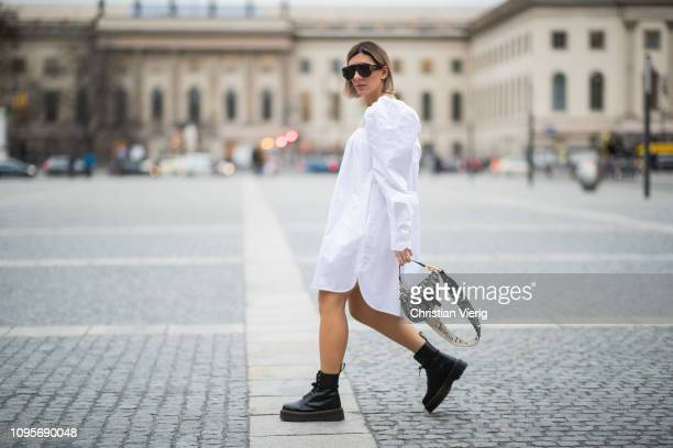 Aylin Koenig is seen wearing white dress Calvin Klein 205W39NYC Dior saddle bag Dior sunglasses Dr Martens boots during the Berlin Fashion Week...
