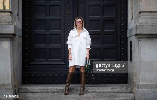 e01aefbb0b3 Aylin Koenig is seen wearing white dress Calvin Klein 205W39NYC Fendi boots  Fendi bag Carrera sunnies