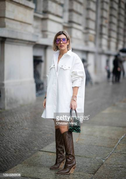 Aylin Koenig is seen wearing white dress Calvin Klein 205W39NYC Fendi boots Fendi bag Carrera sunnies during the Berlin Fashion Week Autumn/Winter...