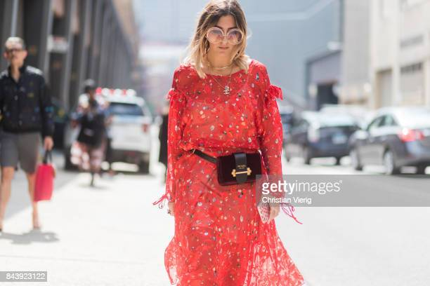 Aylin Koenig seen wearing a red Preen dress Prada belt bag in the streets of Manhattan outside Desigual during New York Fashion Week on September 7...