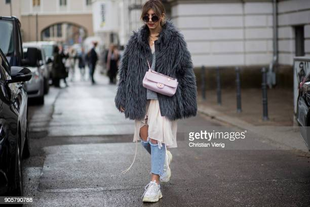 Aylin Koenig weairng Balenciaga sneakers Chanel bag is seen outside Der Berliner Modesalon during the Berlin Fashion Week January 2018 on January 16...
