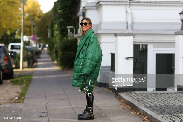 Aylin Koenig wearing a Baum Pferdgarten jacket Prada bag latex pants from topshop Louis Vuitton boots and a Celine sunglasses on October 08 2018 in...