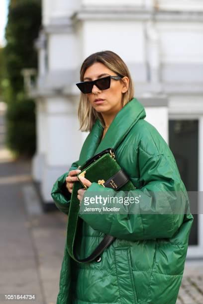 Aylin Koenig wearing a Baum Pferdgarten jacket Prada bag latex pants from topshop Louis Vuitton boots and a Celine sunglasses on October 08 2018 in...