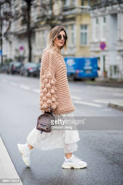 Aylin Koenig wearing a beige knit from Moms Handmade white Balenciaga sneakers mini Louis Vuitton backpack white dress HM Studio round RayBan...