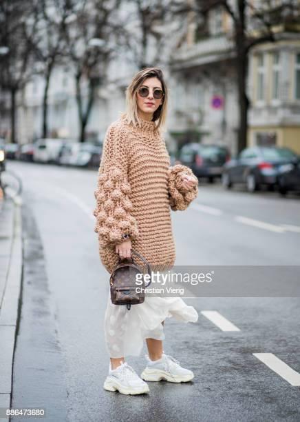 Aylin Koenig wearing a beige knit from Moms Handmade white Balenciaga sneakers mini Louis Vuitton backpack white dress HM Studio round RayBan...
