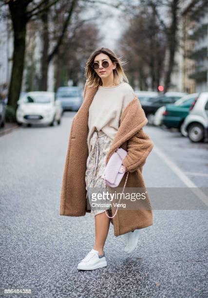 Aylin Koenig wearing a beige Max Mara coat white sneakers Alexander McQueen By Malene Birger knit Zimermann dress pink Chanel bag Ray Ban sunglasses...