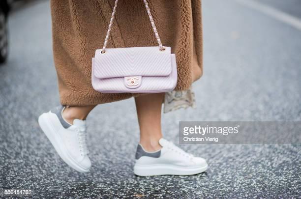 Aylin Koenig wearing a beige Max Mara coat white sneakers Alexander McQueen By Malene Birger knit Zimermann dress pink Chanel bag Ray Ban sunglasses...
