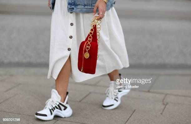 Aylin Koenig wearing a Chanel belt bag Louis Vuitton sneaker Cartier jewelry Zara dress on March 27 2018 in Hamburg Germany