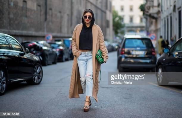 Aylin Koenig wearing a green Gucci bag brown wool coat hoody denim jeans is seen outside Max Mara during Milan Fashion Week Spring/Summer 2018 on...