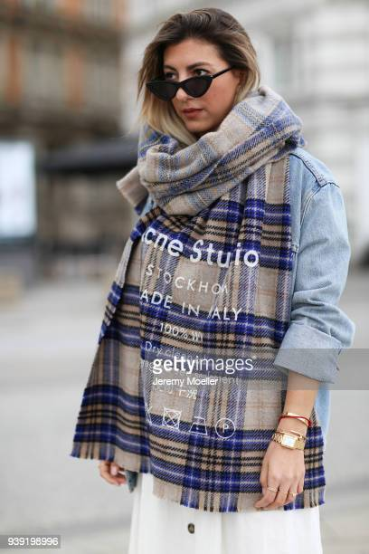 Aylin Koenig wearing a Levis Jeans jacket Acne Studios scarf Cartier jewelry Le Specs sunglasses Zara dress on March 27 2018 in Hamburg Germany