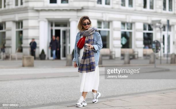 Aylin Koenig wearing a Levis Jeans jacket Acne Studios scarf Chanel belt bag Louis Vuitton sneaker Cartier jewelry Le Specs sunglasses Zara dress on...