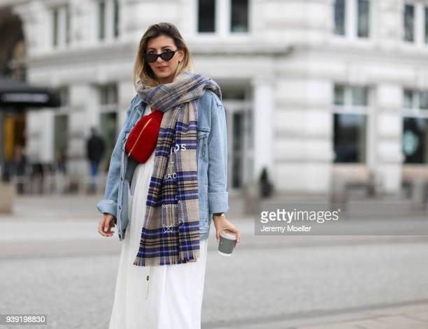 Aylin Koenig wearing a Levis Jeans jacket Acne Studios scarf Chanel belt bag Cartier jewelry Le Specs sunglasses Zara dress on March 27 2018 in...