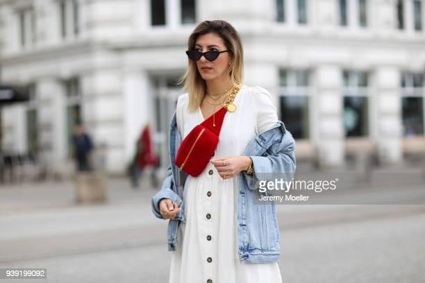 Aylin Koenig wearing a Levis Jeans jacket Chanel belt bag Cartier jewelry Le Specs sunglasses Zara dress on March 27 2018 in Hamburg Germany