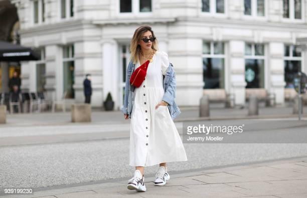 Aylin Koenig wearing a Levis Jeans jacket Chanel belt bag Louis Vuitton sneaker Cartier jewelry Le Specs sunglasses Zara dress on March 27 2018 in...