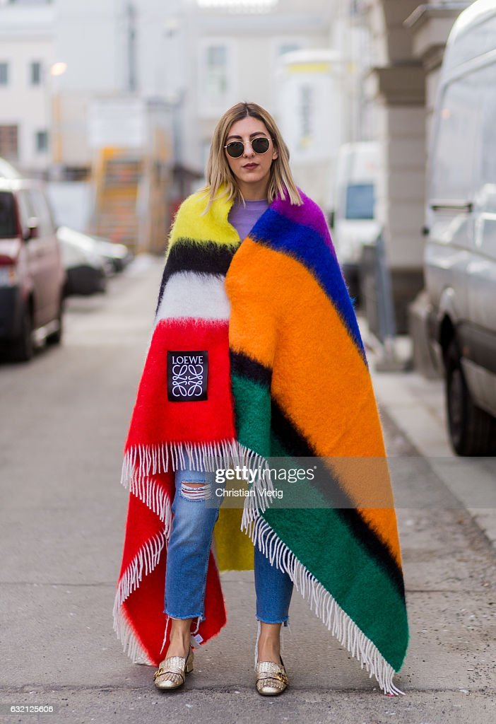 Aylin Koenig wearing a Loewe blanket, ripped denim jeans, Gucci shoes during the Mercedes-Benz Fashion Week Berlin A/W 2017 at Kaufhaus Jandorf on January 19, 2017 in Berlin, Germany.