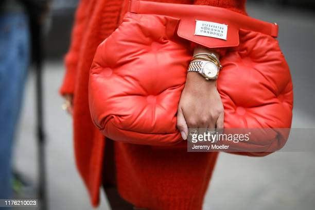 Aylin Koenig wearing a Maison Margiela bag and Rolex watch poses outside the Max Mara show during Milan Fashion Week Spring/Summer 2020 on September...