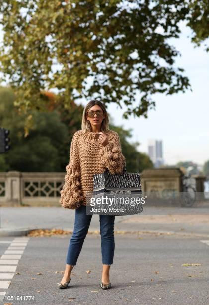 Aylin Koenig wearing a Mumshandsmade sweater Topshop jeans Balenciaga slippers and Christian Dior bag on October 08 2018 in Hamburg