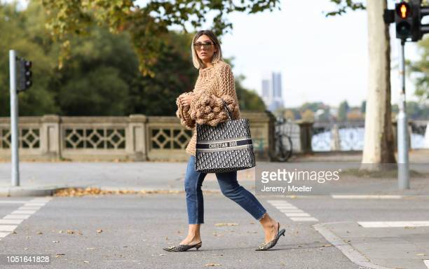 Aylin Koenig wearing a Mumshandsmade sweater Topshop jeans Balenciaga slippers and Christian Dior bag on October 08 2018 in Hamburg