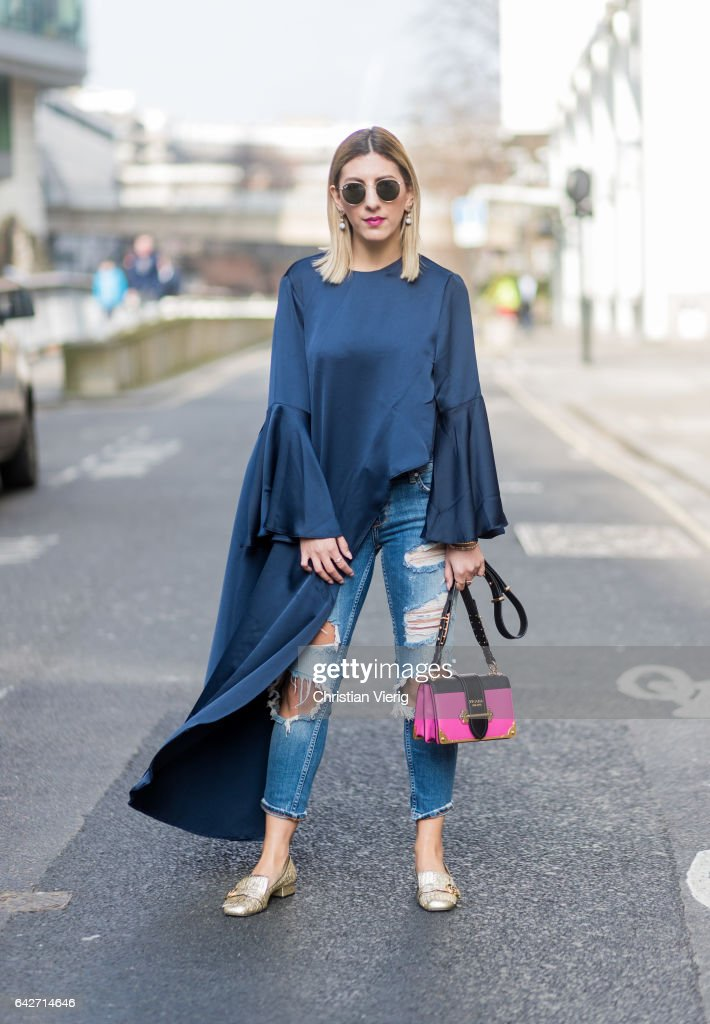 Aylin Koenig wearing a Prada bag, Gucci slippers, ripped denim jeans, white navy top outside Julien Macdonald on day 2 of the London Fashion Week February 2017 collections on February 18, 2017 in London, England.