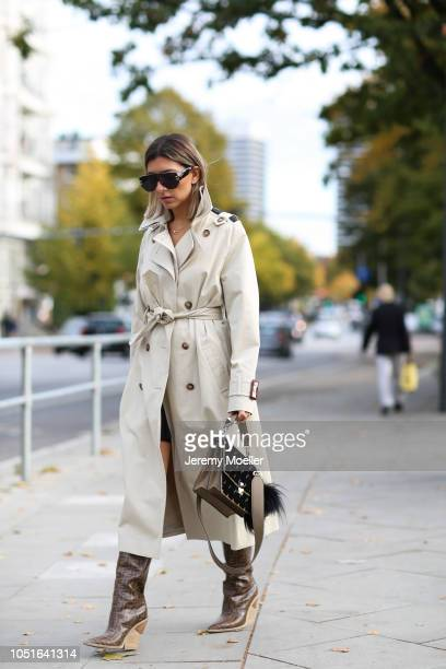 Aylin Koenig wearing a Strenesse x Styleshiver coat Fendi boots and bag Dior sunglasses and Cartier jewelry on October 08 2018 in Hamburg
