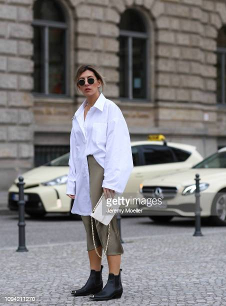Aylin Koenig wearing a Topshop skirt Chanel bag Calvin Klein boots and Acne Studios blouse during the Berlin Fashion Week Autumn/Winter 2019 on...
