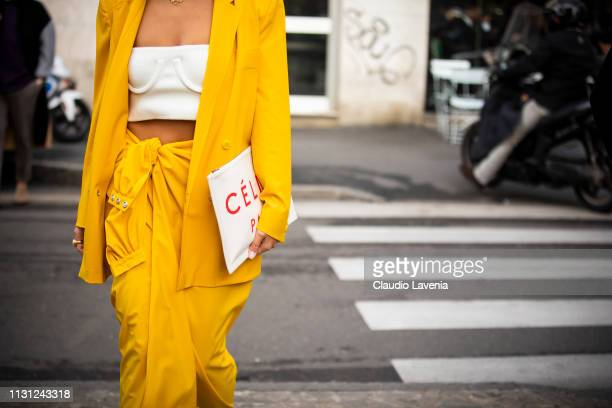 Aylin Koenig wearing a yellow jacket and skirt and a white Celine bag is seen outside Max Mara on Day 2 Milan Fashion Week Autumn/Winter 2019/20 on...